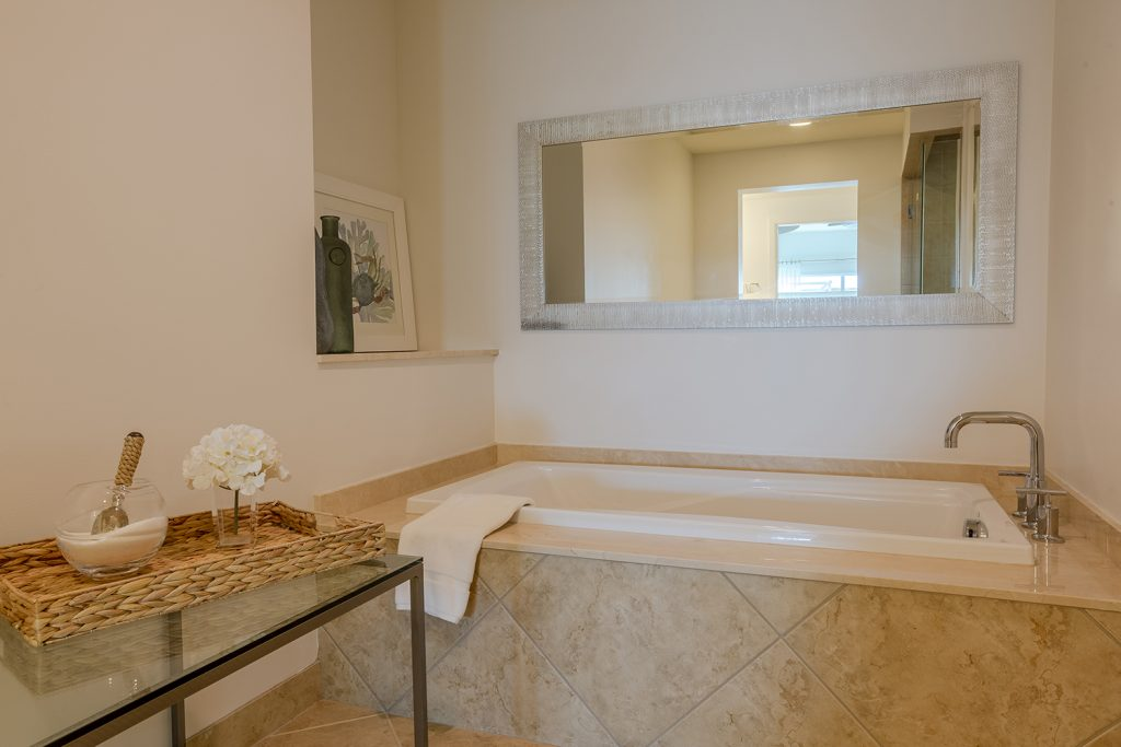 Master bath large soaking tub. Relax. Peaceful.