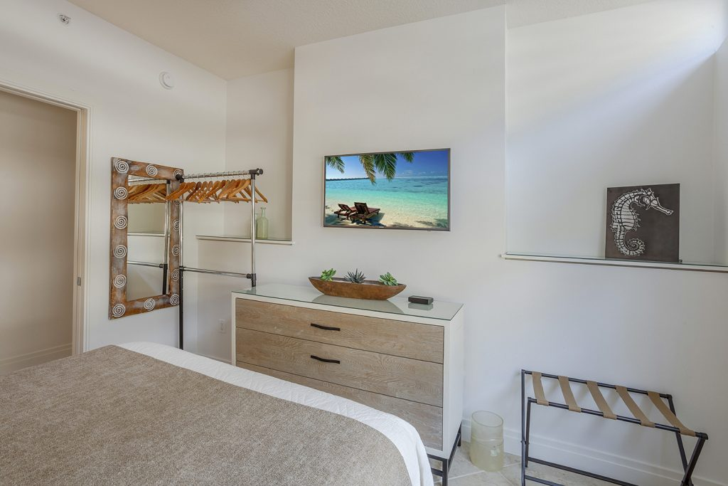 Second bedroom. Contemporary beach furnishings. Smart TV. Ceiling fan.