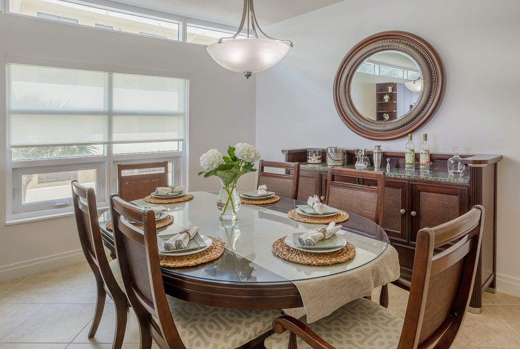 Dining for 6. Stocked buffet and barware. Open concept with natural light. Entertain on the large table or play games.