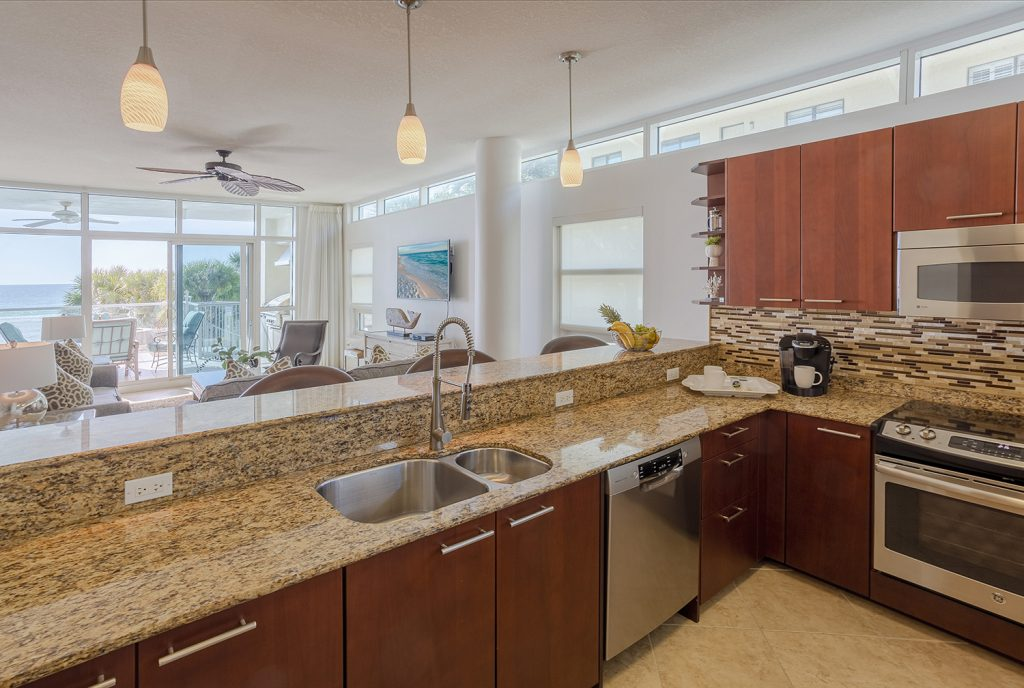 Open concept Kitchen. Well stocked Kitchen. New Stainless steel appliances. Views of the Beach from the kitchen