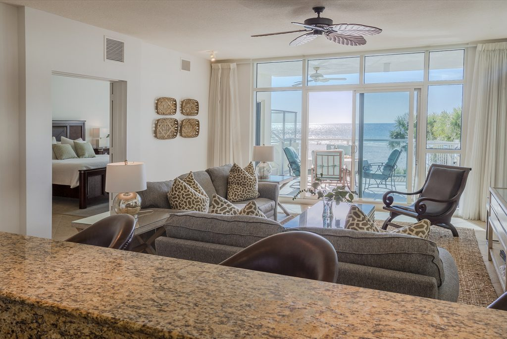 Each view from the kitchen.  Open seating. Breakfast bar. Coastal casual furnishings.