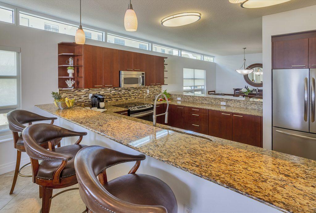Well stocked kitchen. Stainless appliances. Clean. Breakfast bar. Plenty of storage.