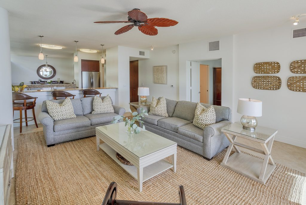 Open Concept living. Coastal Casual living room. Barefoot luxury. Ceiling fan. Functional layout. High ceilings and natural light. Plenty of seating.