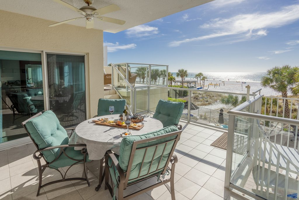 Beach front views on deck. Comfortable Sunbrella seating. Covered eating area.